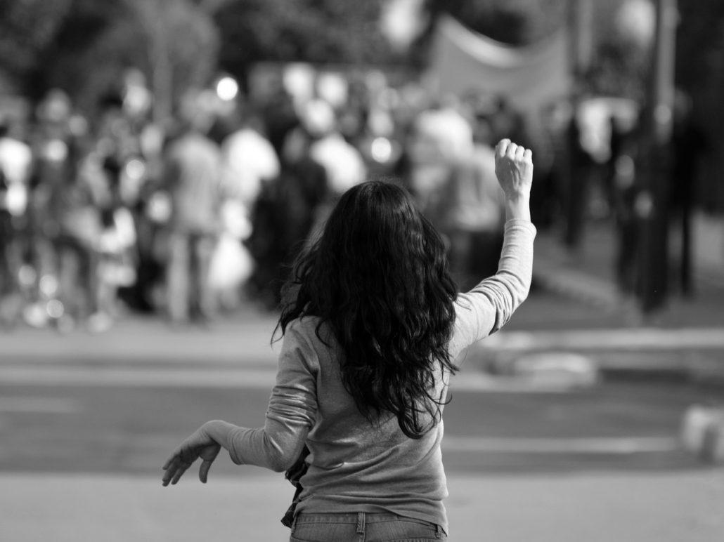 woman raising arm